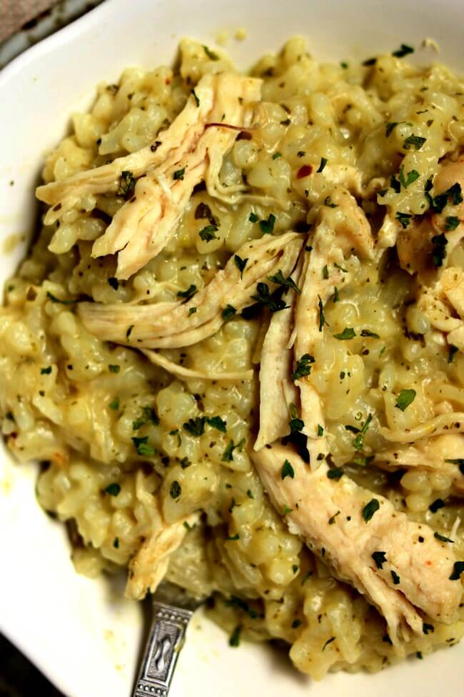 Instant Pot Pesto Chicken Risotto--creamy no fuss and no stir pesto risotto with tender bites of chicken quickly in your electric pressure cooker.