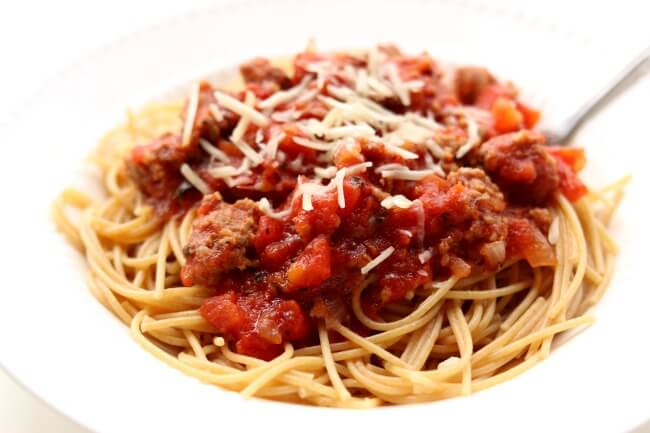 Slow Cooker Homemade Spaghetti Sauce--a meaty slow cooker spaghetti sauce that only takes just minutes to get going and then simmers all day in your crockpot. I like to serve this sauce over any pasta or over spaghetti squash.