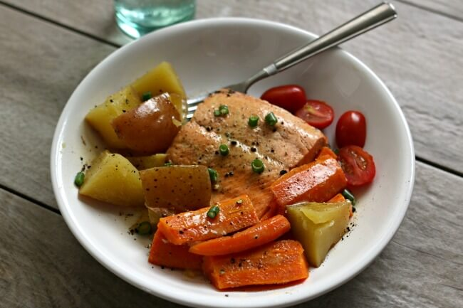 Instant Pot Lemon Butter Garlic Salmon with Homestyle Vegetables--flaky wild Alaska salmon is steamed on the top of red potatoes and carrots in your electric pressure cooker and topped with garlic, fresh lemon juice and butter. A one pot meal that is healthy and delicious!