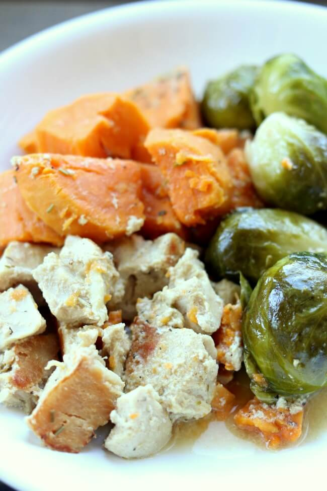 Slow Cooker Maple Dijon Chicken and Sweet Potatoes--chicken, sweet potatoes and brussels sprouts drizzled with a sauce made with maple syrup, dijon mustard, rosemary and olive oil. A simple one pot recipe with a delicious flavor!