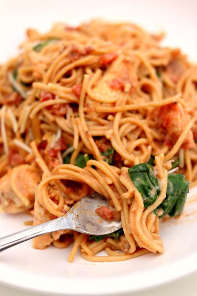 Instant Pot Creamy Chicken Bacon Spaghetti--tender bites of chicken are with spaghetti in your electric pressure cooker. The spaghetti is tossed with crumbled bacon, spinach, tomatoes, garlic and parmesan for a flavorful meal that the whole family will love.