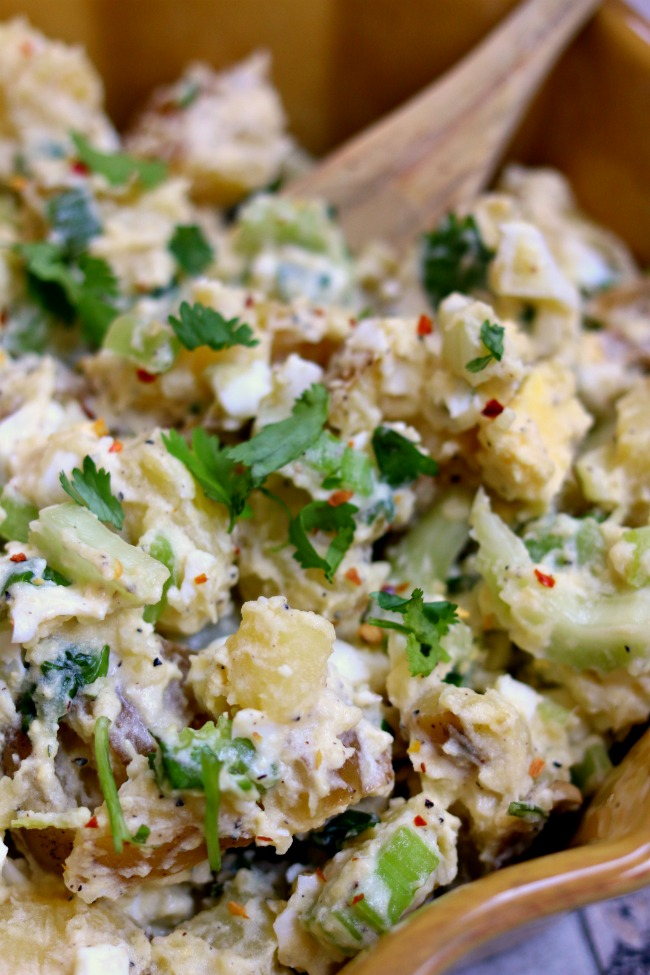 Instant Pot Cilantro Lime Potato Salad--cilantro and a hint of lime create a memorable take on classic potato salad. By cooking the eggs and potatoes together in your Instant Pot you'll cut down on steps, dishes and time! Try this recipe out and you may never go back to regular potato salad again.