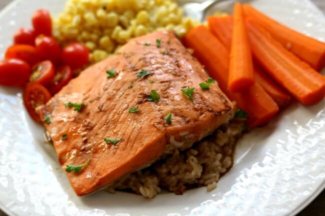 Instant Pot Teriyaki Salmon and Rice--frozen salmon fillets are thrown into your electric pressure cooker with some rice and cooked until flaky. This is such an easy and fast way to make salmon. Serve your salmon and rice with veggies and you have a complete meal.