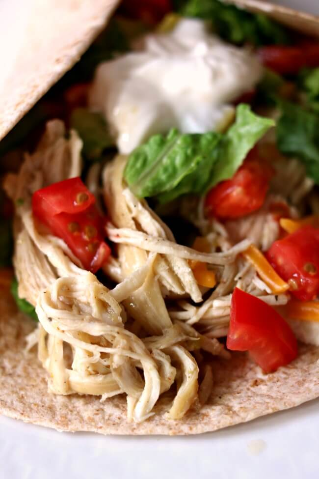 Instant Pot/Slow Cooker 3-Ingredient Lime Chicken Tacos (from frozen)--this is the easiest and tastiest shredded chicken that you can serve in tacos (or other ways). The best part is that you can use frozen chicken and it takes about 2 minutes of prep time.