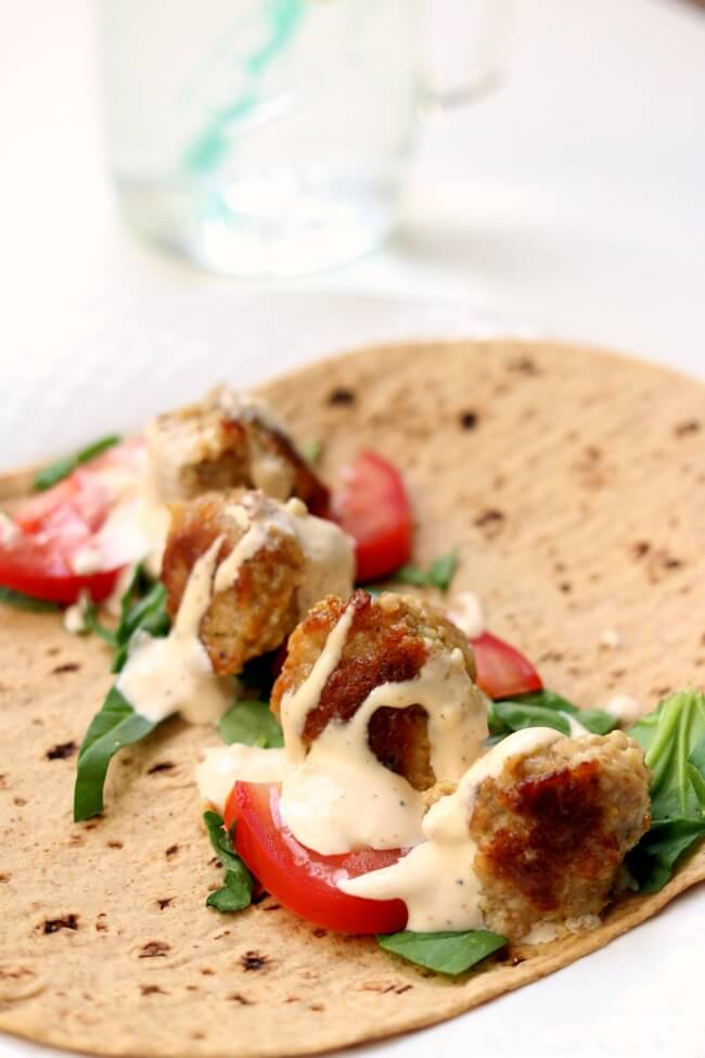 Instant Pot Lemon Chicken Meatball Wraps with Spicy Garlic Sauce--flavorful lemon chicken meatballs are served rolled up in flatbread with lettuce, tomato and a sour cream/mayo mixture with lots of garlic and sriracha flavor. A perfect summer meal!