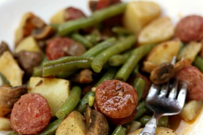 Instant Pot Cajun Sausage, Potatoes and Green Beans--a quick and easy one pot meal of cajun-style andouille sausage, quartered red potatoes, fresh green beans and sliced mushrooms. Drizzle the buttery broth over the potatoes for maximum flavor.
