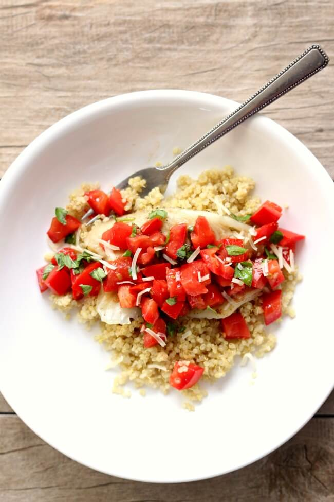 Instant Pot Tomato Basil Tilapia--steamed tilapia is topped with diced tomatoes, olive oil, fresh basil, salt and pepper. This is a light and fresh summer meal that can be prepared and ready to eat in just a few minutes.