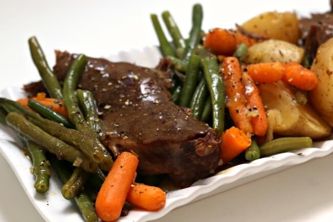 Instant Pot Grandma's Sunday Roast--get fall apart roast paired with potatoes, carrots, green beans and gravy made quickly in your pressure cooker. A perfect Sunday dinner just like Grandma used to make.