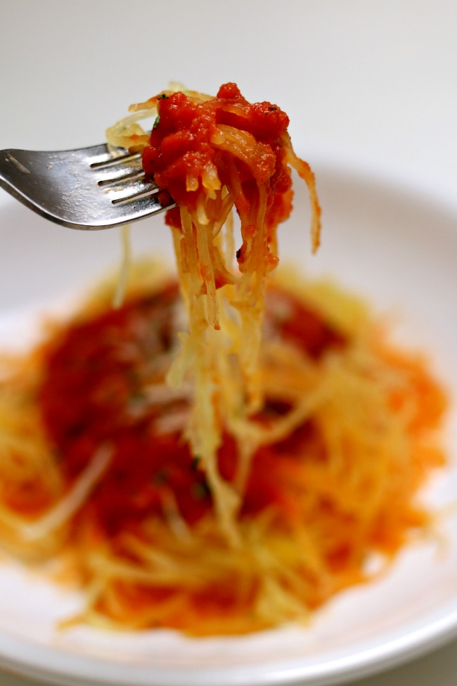 Easy Slow Cooker Spaghetti Sauce and Spaghetti Squash--this spaghetti sauce is so delicious you'll be licking your plate. The funny part is that it only takes a handful of easy ingredients. Bonus--if you want to cook a spaghetti squash at the same time as the sauce you can!