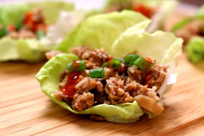 Instant Pot Chicken Lettuce Wraps--an incredibly easy and delicious recipe for lettuce wraps. Hoisin sauce gives these ground chicken lettuce wraps lots of flavor and the rice and water chestnuts adds texture. Get a whole head of lettuce ready because you're not going to want to stop eating these chicken lettuce wraps!