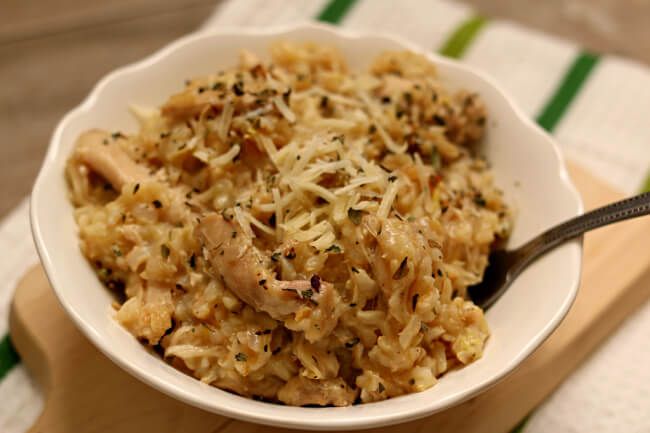 Instant Pot Lemon Chicken and Rice--brown rice is cooked with garlic, onion, lemon juice and juicy chicken thighs for a easy one pot dinner that's low on effort and high on taste.