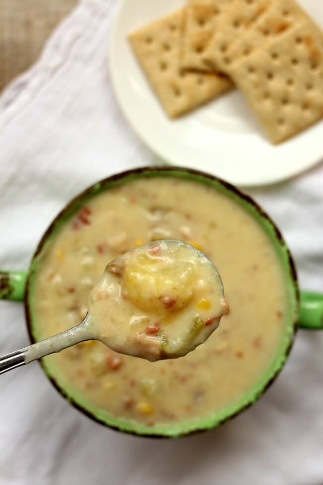 Slow Cooker Clam Chowder--a thick and creamy chowder with bacon, corn, potatoes, celery and minced clams.