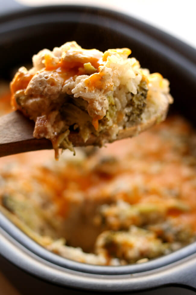 Crockpot Cheesy Broccoli Rice Casserole--the casserole from your childhood that's made easy in the slow cooker! Creamy rice, broccoli florets, sharp cheddar cheese and your choice of either chicken or ham are combined to make a perfect side dish or main dish.