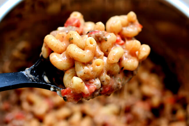 Instant Pot Homemade Hamburger Helper--with just a little more effort than making a boxed meal you can have a homemade creamy tomato basil beef pasta meal. And with the help of your Instant Pot it takes just a few minutes.