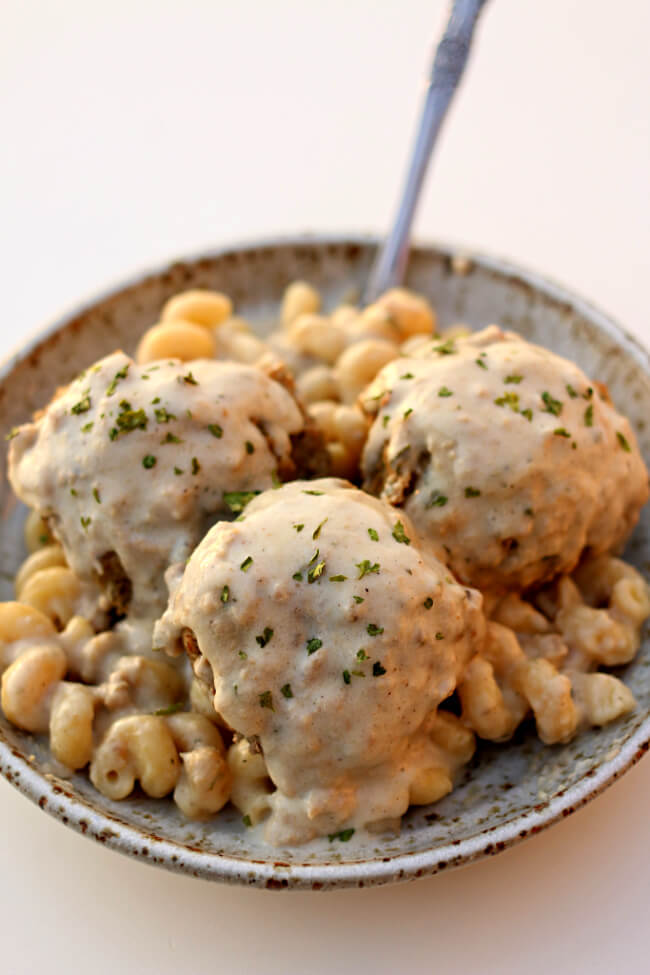 Instant Pot Chicken Alfredo Meatballs--chicken meatballs are served alongside pasta with an easy, homemade alfredo sauce. Pasta, meatballs and sauce are all cooked in one pot--your Instant Pot.