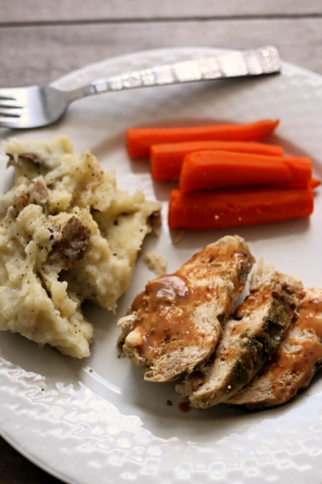Instant Pot Chicken and Mashed Potatoes--chicken, mashed potatoes, carrots and gravy are all prepared in one pot, your Instant Pot. A perfect dinner for any night of the week.
