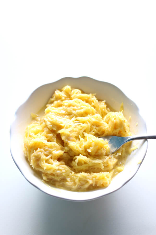 Instant Pot Spaghetti Squash Mac and Cheese--if you're looking for a lower calories and lower carb way to enjoy mac and cheese this recipe is for you. Spaghetti squash is cooked quickly in your electric pressure cooker and then a cheesy sauce is stirred in with the squash strands to make a comforting meal.