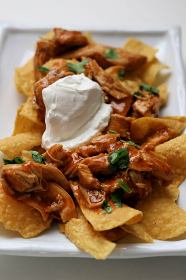 Instant Pot 5-Ingredient Enchilada Chicken--a fast and easy dump and go recipe. The saucy chicken can be served in tacos, burritos, salads, nachos, quesadillas or over rice.