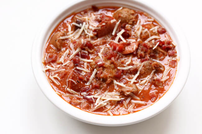 Slow Cooker Meat Lovers Soup--if you're a fan of all the meats you're going to love this hearty soup. With meatballs, smoked sausage, brats, bacon, pepperoni and ground beef there is literally meat in every single bite. If you have a carnivore in your life they will love this dinner!