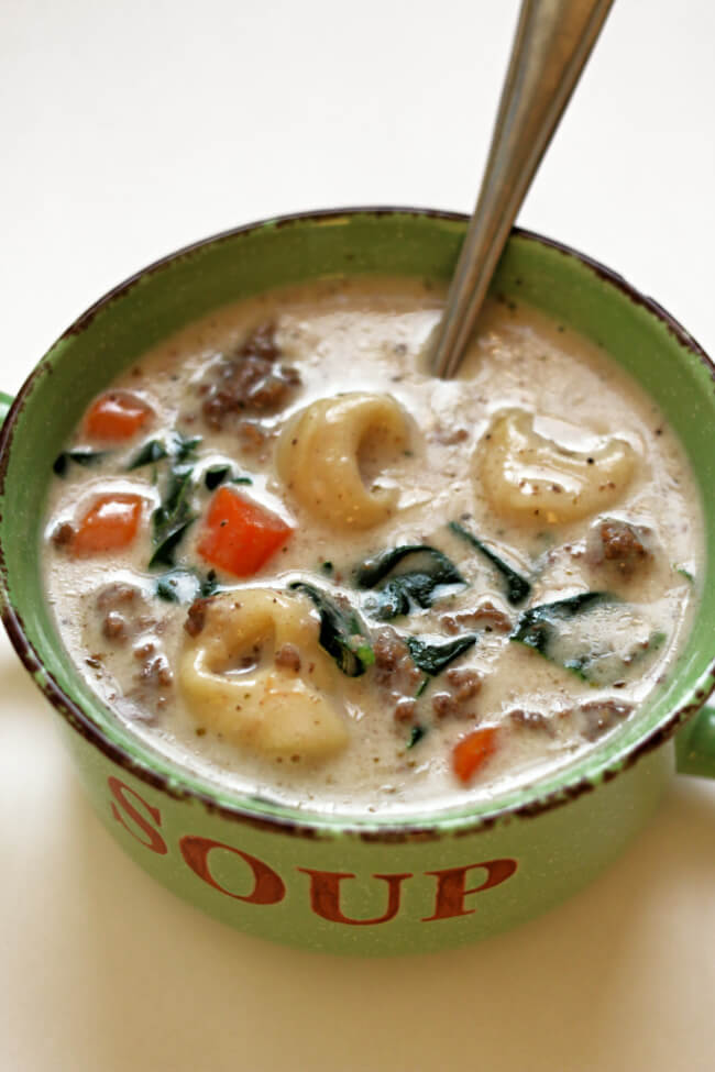 Instant Pot Creamy Hamburger Tortellini Soup is a creamy soup with ground beef, spinach, carrots and cheesy tortellini. Make it all in one pot and in just a few minutes with your electric pressure cooker.