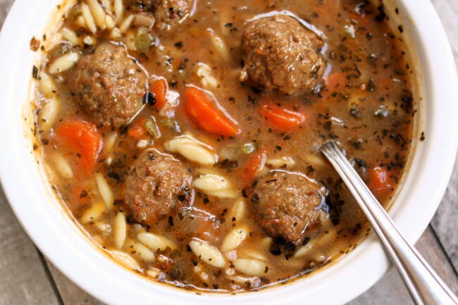 Instant Pot Italian Wedding Soup--a quick and easy version of a popular soup. A flavorful brothy soup with orzo and meatballs.