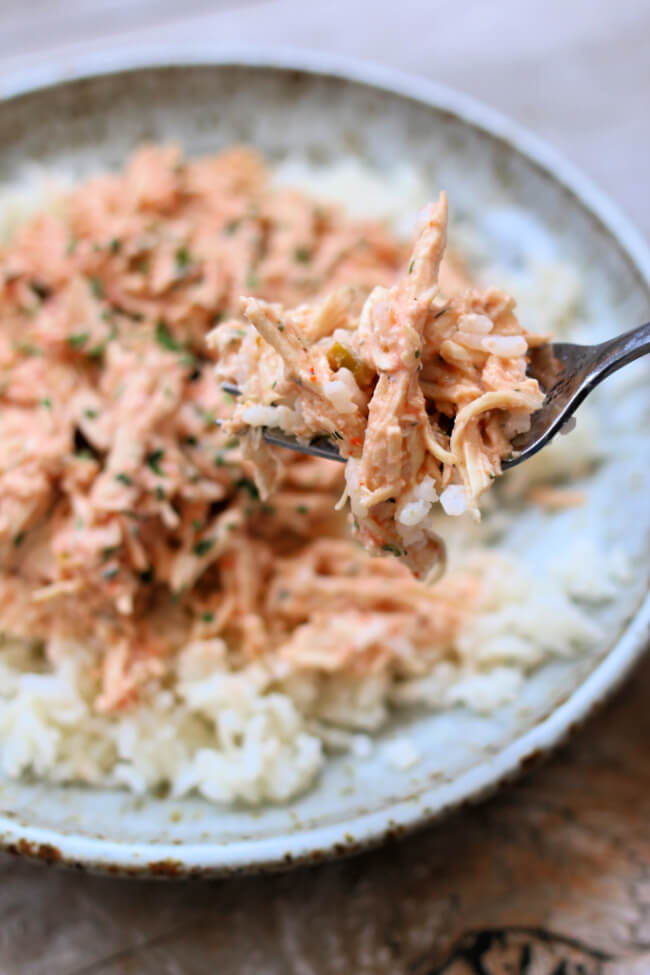 Instant Pot Fiesta Lime Chicken--shredded chicken with a creamy, flavorful sauce that's made quickly in your Instant Pot. And you can make rice at the same time in the same pot to serve with the chicken. An easy dinner for any night of the week.