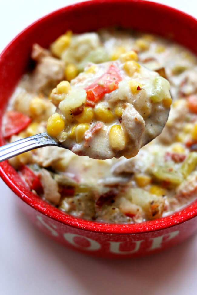 """Instant Pot Chicken Bacon Chowder--this chowder is definitely a party in your mouth. With corn, chicken, bacon, cream cheese, potatoes, carrots, red bell pepper and more it's chock full of tastiness. You're going to be saying """"let's make this again next week"""" once you try it."""
