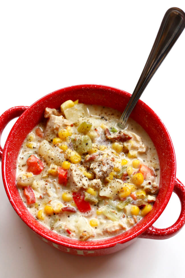 "Slow Cooker Chicken Bacon Chowder--this chowder is definitely a party in your mouth. With corn, chicken, bacon, cream cheese, potatoes, carrots, red bell pepper and more it's chock full of tastiness. You're going to be saying ""let's make this again next week"" once you try it."