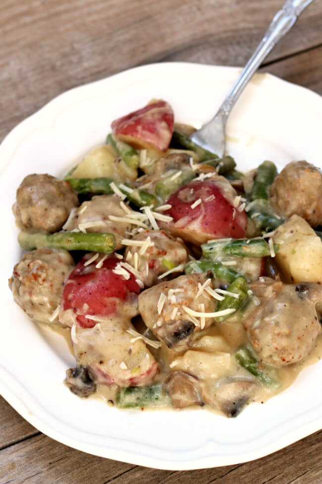 Instant Pot Meatballs and Red Potatoes with Creamy Parmesan Sauce--Red potatoes, green beans, meatballs and mushrooms are all covered in a creamy parmesan sauce. An easy one pot meal. Frozen meatballs are used for easy prep purposes.