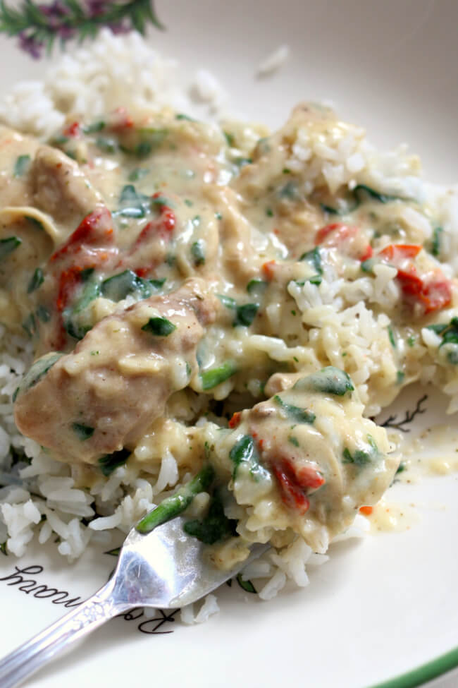 Instant Pot Creamy Tuscan Chicken--creamy chicken and sauce with sun-dried tomatoes, spinach, Parmesan cheese and garlic.