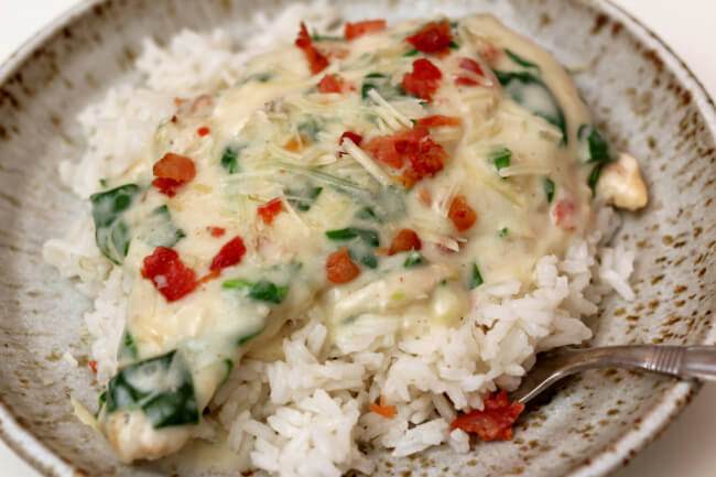 Instant Pot Garlic Parmesan Bacon Chicken--a creamy sauce and chicken with parmesan cheese, bacon, garlic and spinach. Make pot-in-pot rice at the same time to serve with the chicken and sauce.