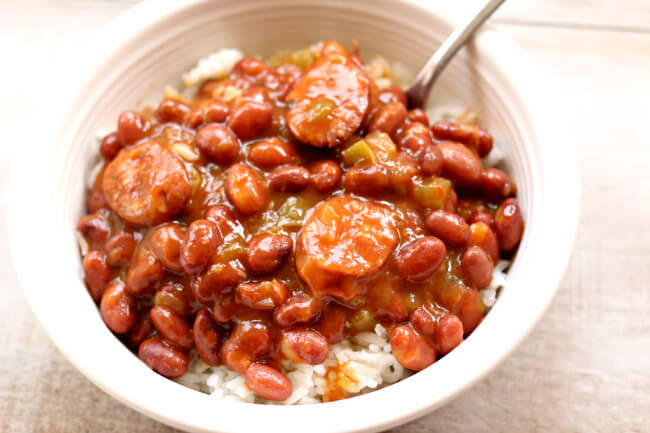 Instant Pot Red Beans and Rice--dried small red beans are pressure cooked quickly and simmered with cajun sausage, onion, green pepper and cajun seasonings to make a saucy stew to serve over rice. And the rice can be cooked at the same time and in the same pot as the red beans!