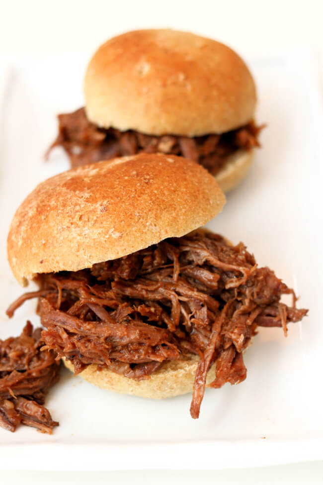 Slow Cooker BBQ Beef Sandwiches--tender shredded beef with an easy homemade barbecue sauce served on a toasted bun. An easy and delicious dinner!