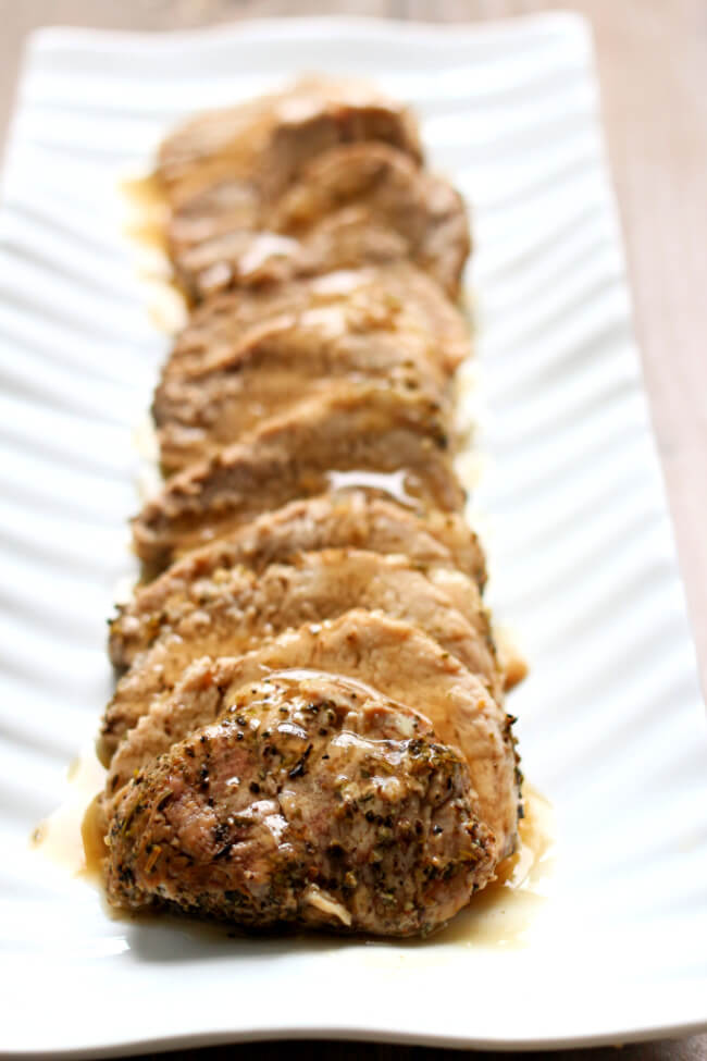 Instant Pot Garlic Pork Tenderloin and Mashed Potatoes--tender slices of seasoned pork with creamy mashed potatoes and gravy. All made in one pot, your Instant Pot.
