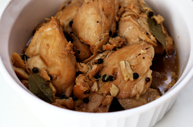 Instant Pot Chicken Adobo--an easy 6-ingredient recipe for the tastiest chicken ever! A Filipino recipe of tender chicken thighs braised in vinegar and soy sauce with lots of garlic.