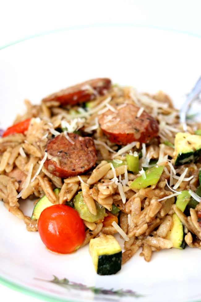 Instant Pot Garlic Chicken Sausage Orzo--orzo pasta with a tangy dijon-balsamic sauce, chicken smoked sausage, zucchini, tomatoes, peppers and parmesan cheese. Loads of flavor and an all in one pot dinner!