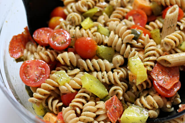 Instant Pot Dill Pickle Pasta Salad--say goodbye to boring pasta salads and hello to this pasta salad that is infused with pickle flavor! Make the pasta quickly and easily with your Instant Pot.