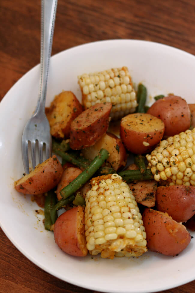 Instant Pot Smoked Sausage Country Boil--A one pot meal with tender red potatoes, sweet corn, fresh green beans and smoked sausage. A perfect summer meal with tons of flavor.