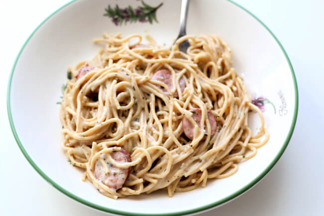 Instant Pot Alfredo Sausage Pasta--flavorful bites of smoked sausage with a creamy (but skinny) sauce that envelopes spaghetti noodles.