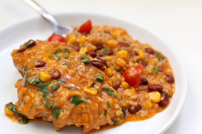 Instant Pot Barbecue Chicken and Rice--an easy one pot meal of saucy, cheesy chicken thighs with black beans, corn and rice.