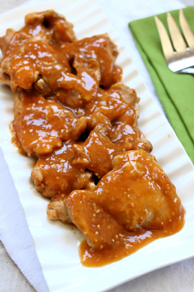 Slow Cooker Firecracker Chicken--sweet and spicy tender pieces of saucy chicken made in your slow cooker.