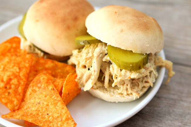 Slow Cooker Honey Mustard Chicken Sandwiches--tender shredded chicken coated with a honey mustard sauce and then served with pickles on top of freshly baked buns.