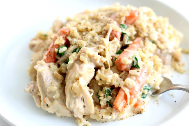 Instant Pot Creamy Chicken Rice Dinner--a simple chicken and rice dinner with carrots and spinach. It's creamy but doesn't have any cream of soups in it and takes just a few minutes to dump everything in and go.