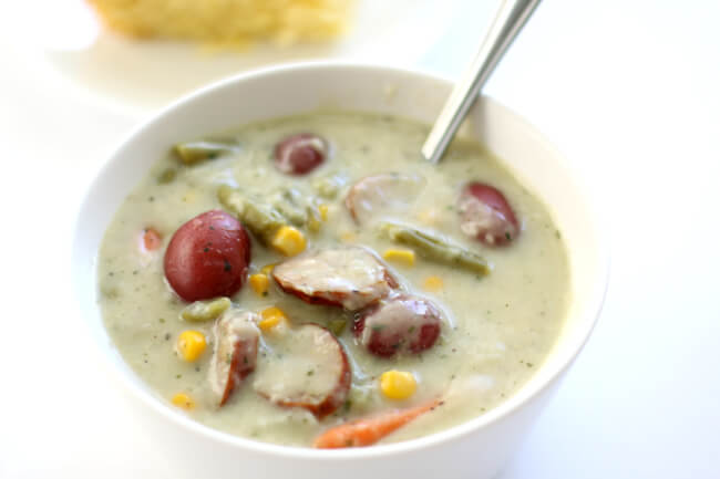Slow Cooker Garlic Parmesan Sausage Chowder--a colorful and flavorful summer chowder with garlic, smoked sausage, parmesan cheese, corn, potatoes, green beans and carrots. Your whole family will love this soup!