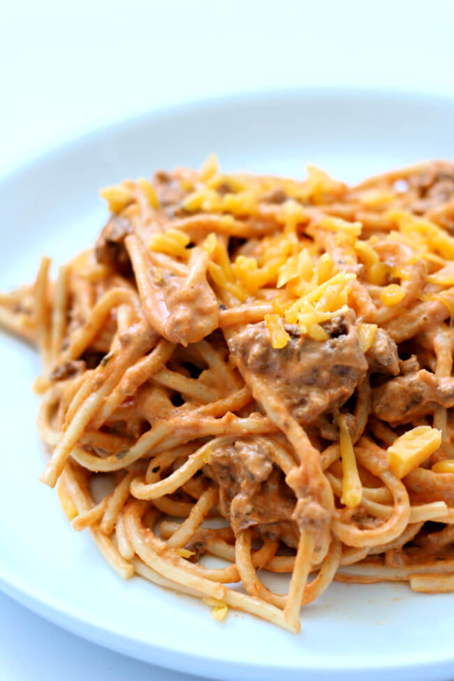 Instant Pot Million Dollar Spaghetti--spaghetti but a whole lot better. A ground beef sauce is served with spaghetti noodles and then cream cheese is stirred in for an ultimate creamy dinner. Kids and adults love this spaghetti!