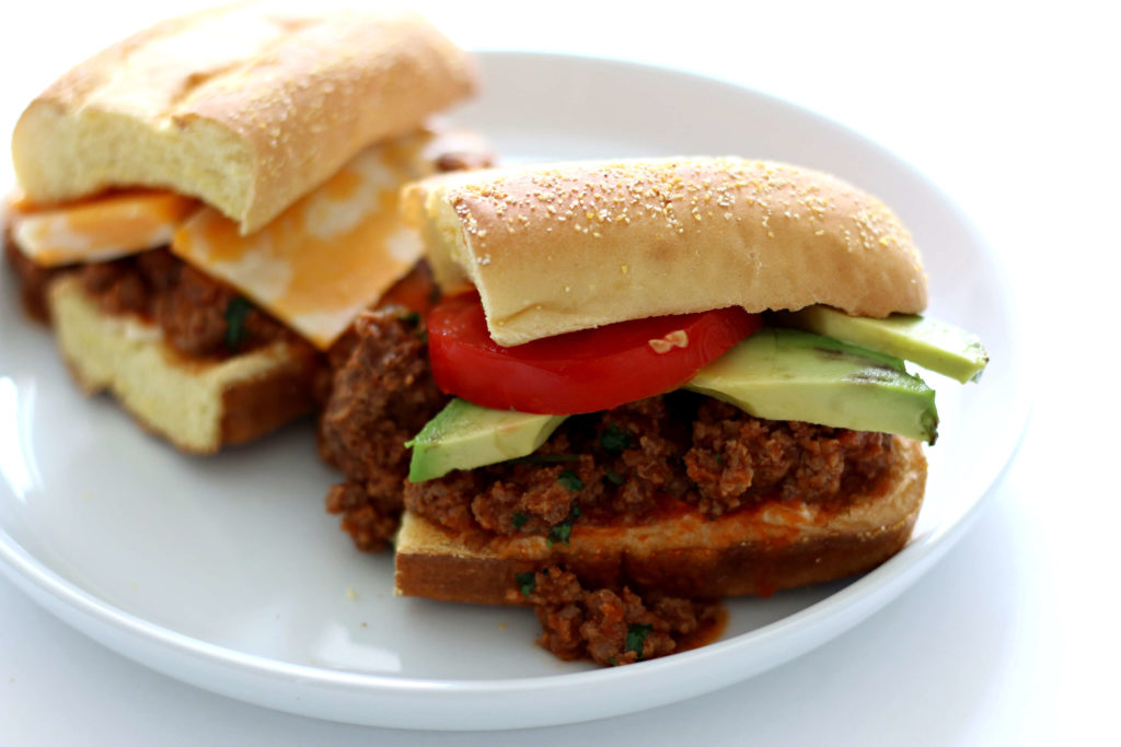 Slow Cooker Southwest Tavern Sandwich--a loose meat sandwich seasoned with southwest flavors and then topped with cheese, avocado and tomato. A perfect dinner or lunch to feed a crowd.
