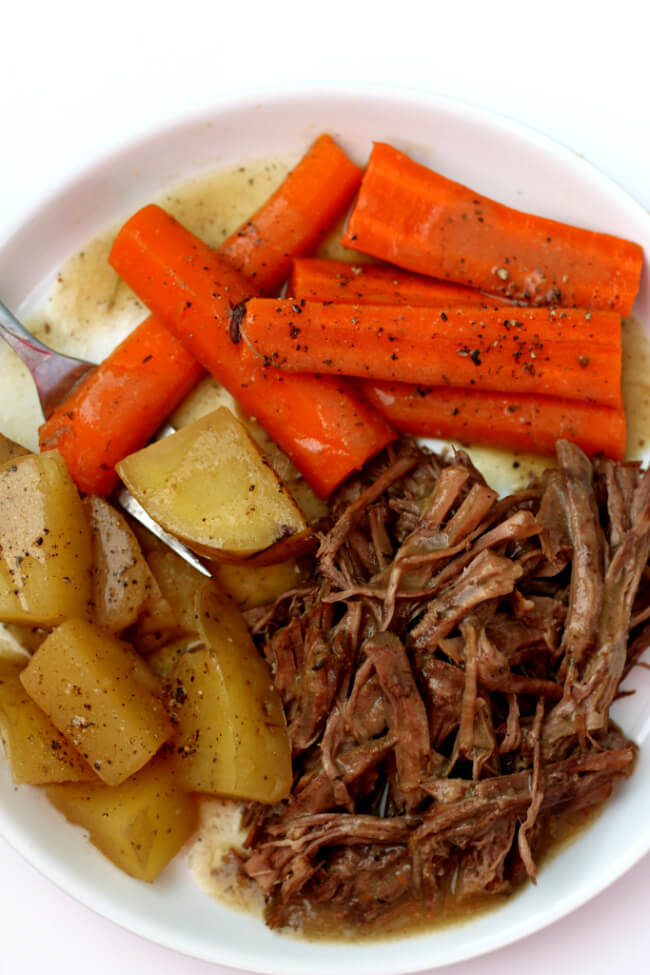 Mom's Slow Cooker Pot Roast--pot roast, potatoes, carrots and gravy just like Mom used to make. An easy recipe that tastes like home.