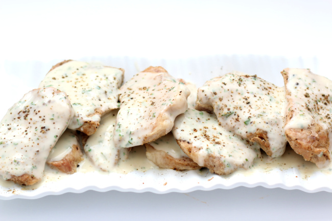 Instant Pot Sour Cream Pork Chops--tasty pork chops with hardly any ingredients. The creamy sauce tastes amazing and this recipe is low carb.