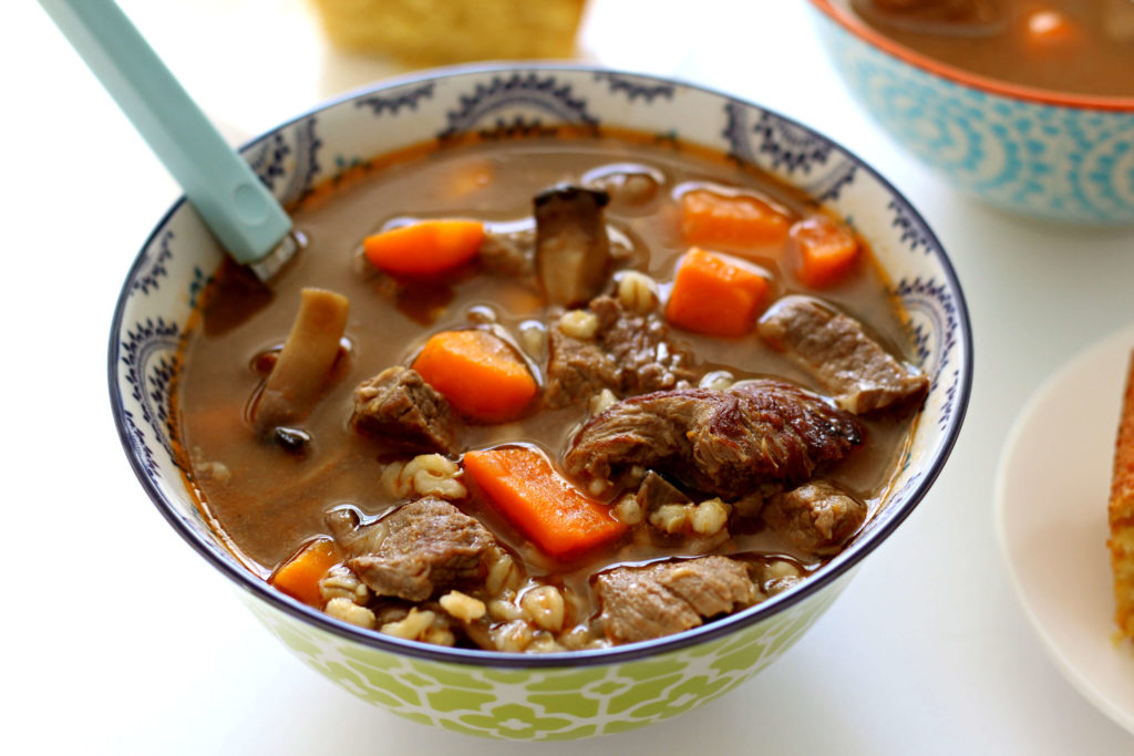 Slow Cooker Beef and Barley Soup--a savory brothy soup with tender bites of beef, chewy barley and vegetables. Let it simmer all day in your slow cooker.