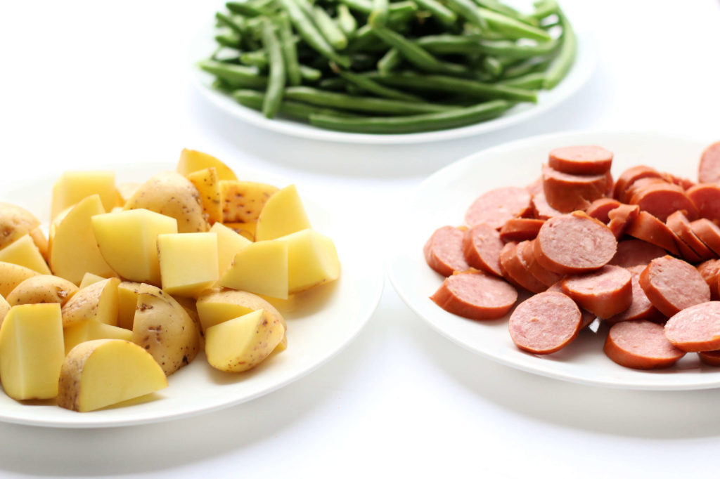 Instant Pot Smoked Sausage, Green Beans and Potatoes--the easiest meal with the most amazing results. Smoked sausage, fresh green beans, cubed potatoes and a couple of seasonings are cooked together quickly in your electric pressure cooker for an easy one pot, dump and press start meal.